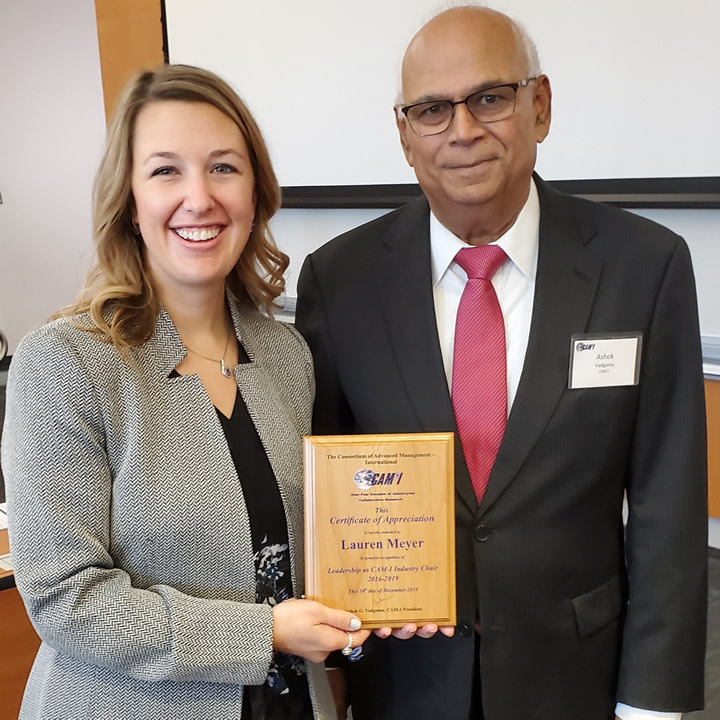 Lauren Meyer, Project Manager, The Boeing Company receiving an award from Ashok Vadgama, CAM-I President
